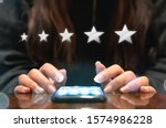 Woman filling out 5 star silver customer service feedback survey by email on smartphone device after hotel guest experience - Company satisfaction rating, retention and quality of service concepts