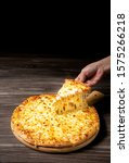 Small photo of Pizza with very much cheese melting