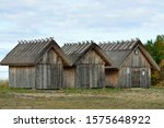 Three Wooden Sheds By The Sea
