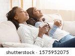 Two Black Girlfriends Resting...