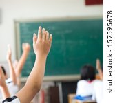 raised hands in class of middle ... | Shutterstock . vector #157595678
