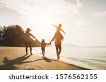 Happy family travel on beach in ...