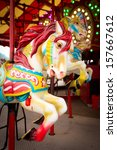 A Colorful Carousel With A Red...