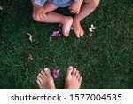 Mom And Daughter Bare Feet On...
