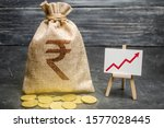 Small photo of Indian rupee INR symbol money bag and red trend arrow up chart. Deposit and savings. Increasing profits and revenues, capital growth, profitable business efficiency. Economic prosperity welfare rise