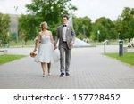 happy bride and groom enjoying... | Shutterstock . vector #157728452