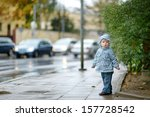 Adorable Toddler Girl At Rainy...