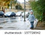 Adorable Toddler Girl At Rainy...