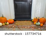 Pumpkins On Front Steps Of Hom...