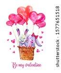 pair of bunnies in basket with... | Shutterstock . vector #1577651518