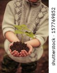 the young man plants a tree. | Shutterstock . vector #157769852