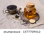 Glass Jar With Oil. Black...