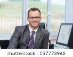 friendly businessman wearing... | Shutterstock . vector #157773962