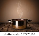 cooking pot on old wooden table | Shutterstock . vector #157775138