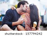 Romantic Couple Kissing While...