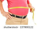 Fat Mature Man Measuring His...