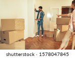 Small photo of Man doing last prearrange for decorating his new home with some awesome furniture