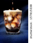Cola With Ice Cubes On  Black...