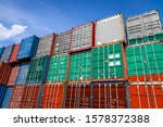 The national flag of Bulgaria on a large number of metal containers for storing goods stacked in rows on top of each other. Conception of storage of goods by importers, exporters