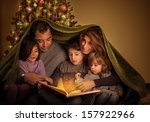 big family reading interesting... | Shutterstock . vector #157922966