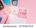 Text sign showing Be Healthy. Conceptual photo to be vigorous and totally free from bodily or mental diseases Calculator clips clock clipboard mouse sheet note pencil color background.