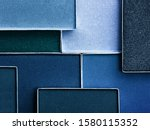 Small photo of Classic blue palette of eye makeup. Color of the year 2020. Classic blue background. Cosmetics products background in trendy color scheme.
