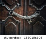Locks And Chains On Door In...