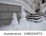 Two Funny Snowmen With Hands...
