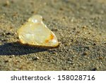 Small photo of Diamond uncut on sand