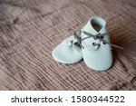 Vintage Baby Shoes On Textured...