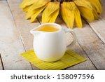 Постер, плакат: Sunflower oil in pitcher