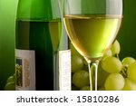 a glass and bottle of white wine and grape - stock photo