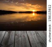beauty sunset over a wooden...   Shutterstock . vector #158115812
