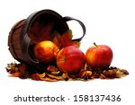 Harvest basket with spilling apples on a white background - stock photo