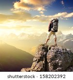 tourist on the mountain top.... | Shutterstock . vector #158202392
