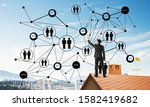 young man standing with back on ... | Shutterstock . vector #1582419682