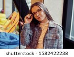 the girl with glasses sits in... | Shutterstock . vector #1582422238