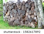 Sawn Old Logs Stacked In A...