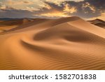 Sunset Over The Sand Dunes In...