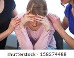 two women comforting crying... | Shutterstock . vector #158274488