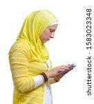 arab muslim woman writing... | Shutterstock . vector #1583023348