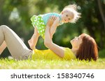 happy mother and daughter in... | Shutterstock . vector #158340746