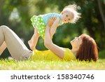 happy mother and daughter in... | Shutterstock . vector #158340746