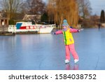 Child Ice Skating On Frozen...