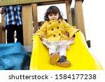 Little Girl Playing On Yellow...