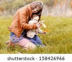 happy young mother holding her... | Shutterstock . vector #158426966