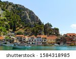 Small photo of Omis, small town, port. Cetina River. Home of pirates. Adriatic coast. Tourist destination. Fortress Mirabella at the peak of the mountain behind the Old town. Cetina canyon. Holiday in Omis. Croatia.