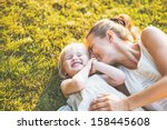 happy mother and baby laying on ... | Shutterstock . vector #158445608