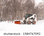 Mini Tractor With Snow Removal...