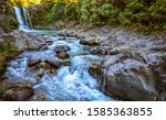 Deep forest river wild waterfall view. Forest river wild landscape. Wild river stream rocks flowing. Forest river rocks view